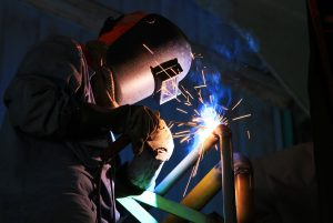 A man working with welding equipment