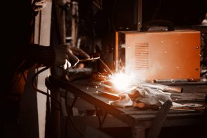 Engineer working with welding flames on work bench