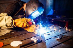 A man welding a piece of steel