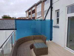 Stainless Hand Rails on a furnished balcony