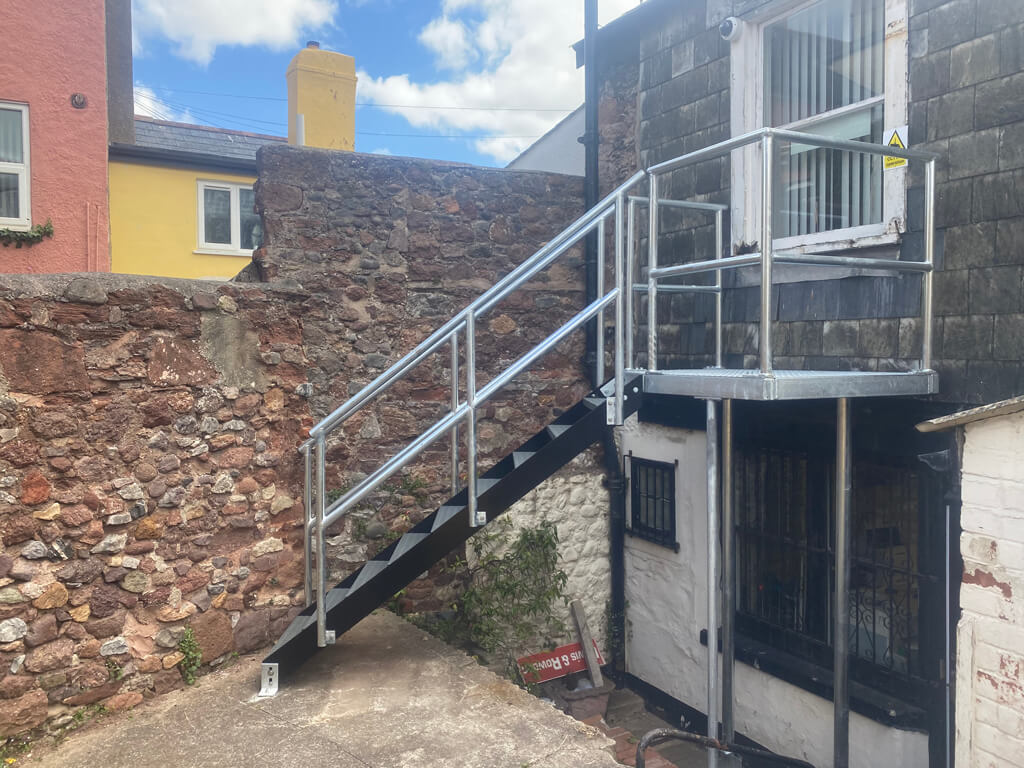 custom fire escape with walkway, steps and balcony