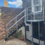 commercial fire escape with walkway, steps and balcony