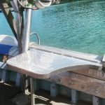 Mounted working table for commercial fishing vessel