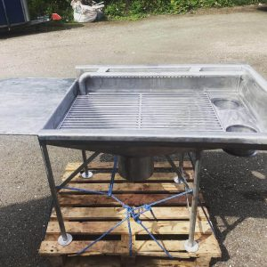 Riddle table with drop in grid, working table and discharge shutes