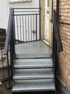 Safety steps with powder coated hand rails