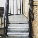 Safety steps with black powder coated hand rails