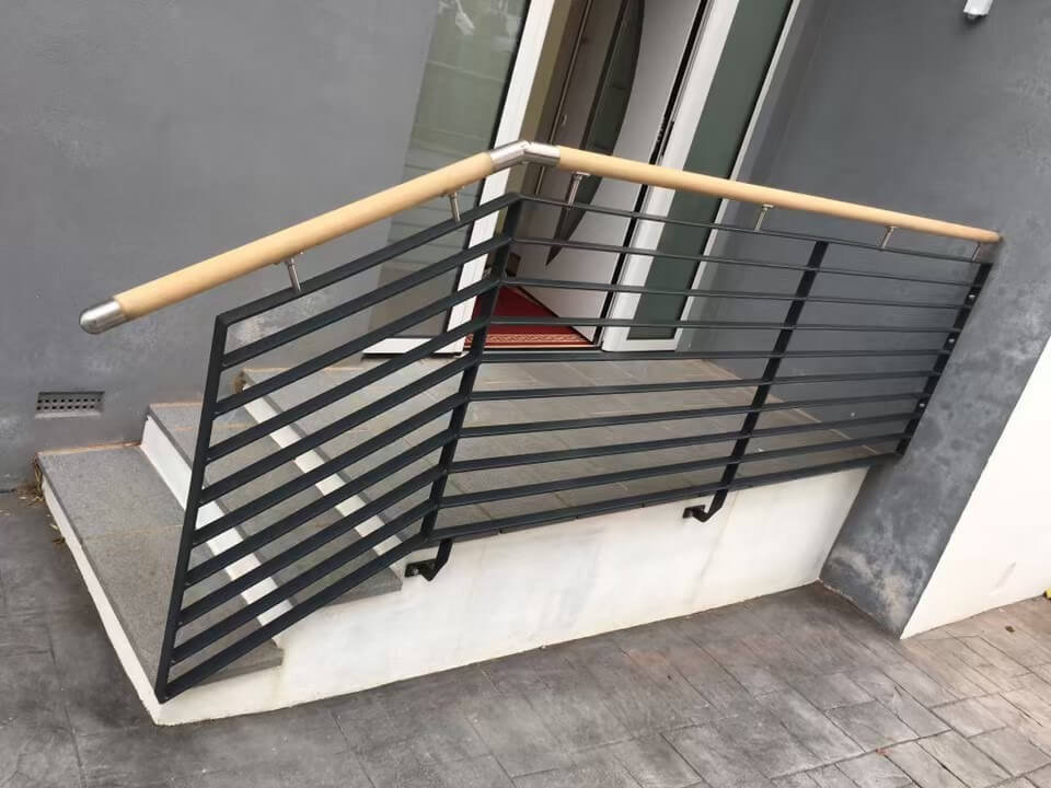 Commercial bespoke power coated hand rails with wooden finish