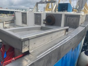 Built in riddle table on a commercial fishing vessel